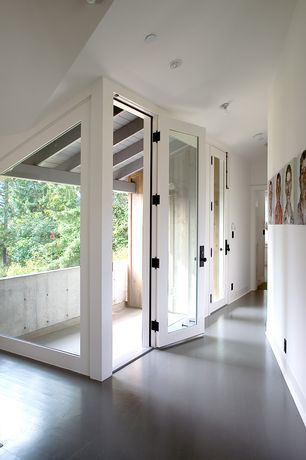 Modern Hallway with Standard height, picture window, can lights, French doors, Concrete floors