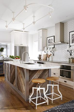 Eclectic Kitchen with L-shaped, Flat panel cabinets, Standard height, Herringbone Tile, wall oven, Reclaimed wood, Paint