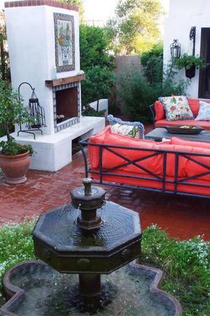 Eclectic Patio with exterior brick floors, Bird bath, Fence, Fountain