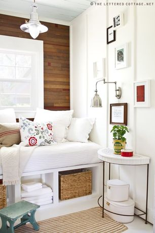 Cottage Guest Bedroom with flush light, Built-in bookshelf, picture window, Reclaimed wood wall, Concrete floors, Paint 1