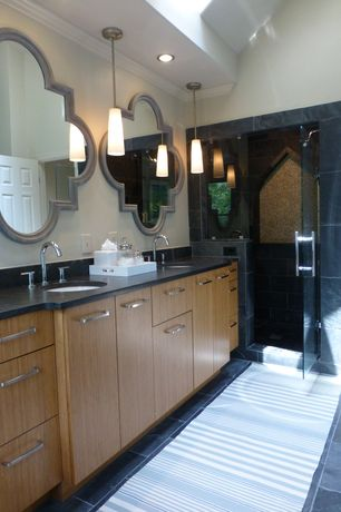 Contemporary Master Bathroom with stone tile floors, Crown molding, Double sink, Flush, European Cabinets, six panel door