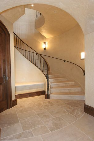 Mediterranean Staircase with limestone floors, can lights, Spiral staircase, Wall sconce, High ceiling, Loft