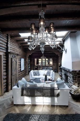 Rustic Living Room with Hardwood floors, Chandelier, specialty door, Skylight, Exposed beam, stone fireplace