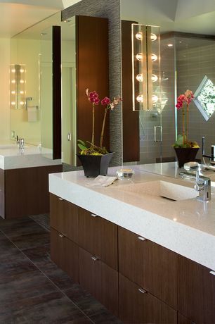 Contemporary Master Bathroom with wall-mounted above mirror bathroom light, stone tile floors, Shower, Flush, flat door