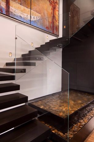 Modern Staircase with Floating staircase, Hardwood floors, Wall sconce