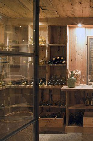 Rustic Wine Cellar with Built-in bookshelf, Exposed beam, simple granite floors