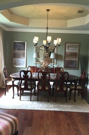 Traditional Dining Room with Chandelier, Carpet, Hardwood floors