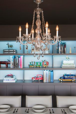 Modern Dining Room with Otis designs new orleans 5-light crystal chandelier, Chandelier, Built-in bookshelf