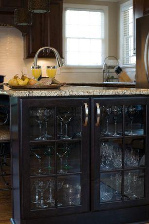 Craftsman Kitchen with Breakfast bar, Simple granite counters, Paint 1, Undermount sink, double-hung window, Kitchen island