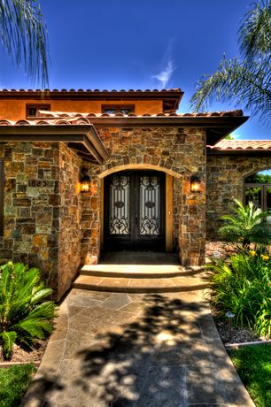 Mediterranean Front Door with French doors, Pathway, exterior stone floors