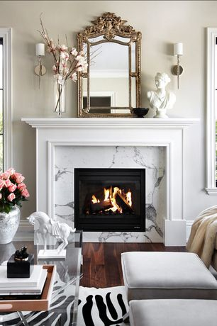 Traditional Living Room with picture window, Fireplace, Standard height, Wall sconce, Hardwood floors, stone fireplace