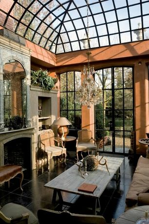 Eclectic Living Room with stone fireplace, French doors, High ceiling, Built-in bookshelf, Skylight, Chandelier