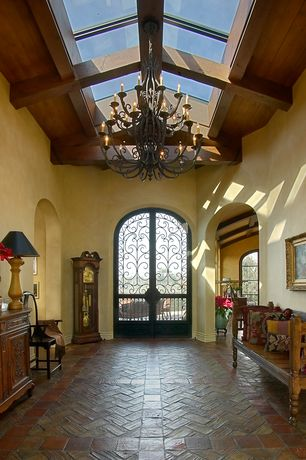 Mediterranean Entryway with Hacienda Leather Seat Rustic Bench, Arched doorway, High ceiling, Chandelier, Skylight