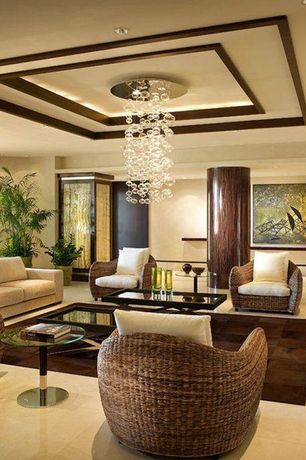 Contemporary Living Room with Pietre vecchie antique ivory, glazed porcelain floor and wall tile, Chandelier, Columns