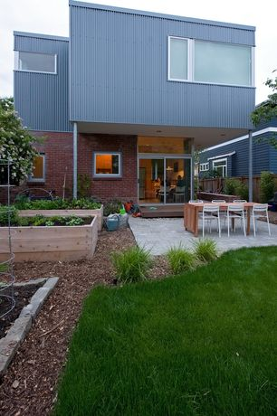 Contemporary Landscape/Yard with Raised beds, Fence, Outdoor kitchen