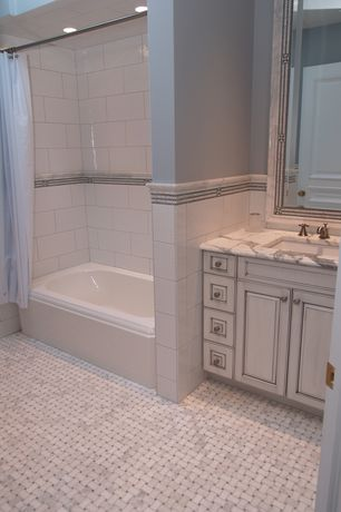 Traditional Full Bathroom with specialty door, Statuary white marble slab countertop, Raised panel, tiled wall showerbath