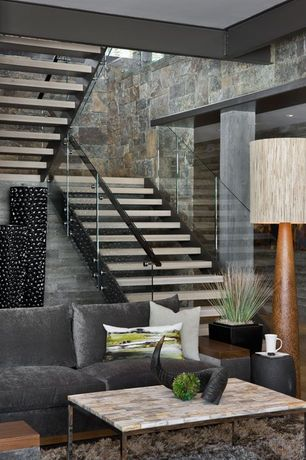 Contemporary Staircase with Columns, Concrete floors, Glass staircase