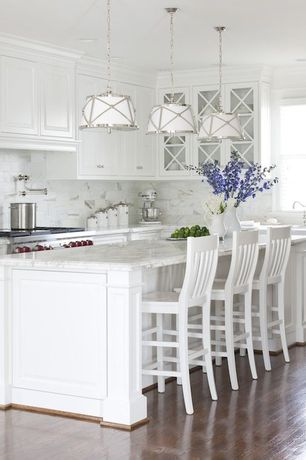 "Cottage Kitchen with Carrara marble countertop, Kitchenaid stand mixer, Marble subway tile (3""x6"" tile), Breakfast bar"