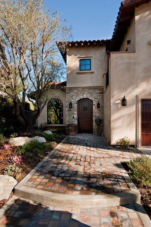 Mediterranean Front Door with Arched window, Barn door, Pathway, exterior tile floors