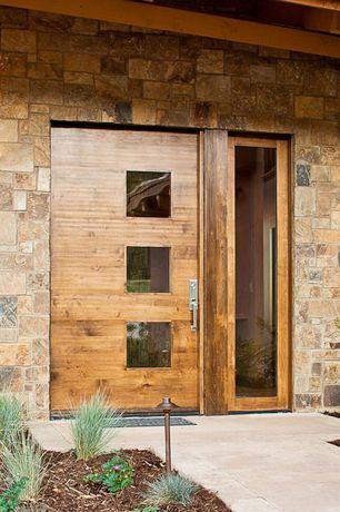 Contemporary Front Door with exterior tile floors, specialty window, exterior concrete tile floors, Glass panel door, Pathway