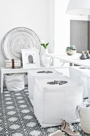 Eclectic Dining Room with Pendant light, Moroccan Leather Pouf, Moroccan tray, Cement tile Shop Roseton Black Tile, Carpet