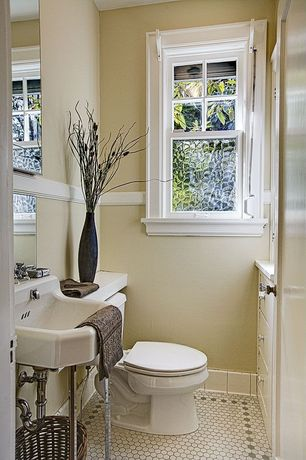 Traditional Powder Room with penny tile floors, Casement, Paint 1, Powder room, Standard height, Pedestal sink, Chair rail