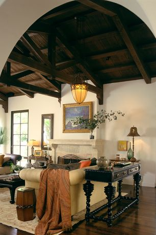 Mediterranean Living Room with Fireplace, Pendant light, stone fireplace, Casement, High ceiling, Hardwood floors