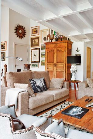 Rustic Living Room with Reclaimed wood coffee table, Standard height, Upholstered armchair, Box ceiling, Table lamp, Artwork