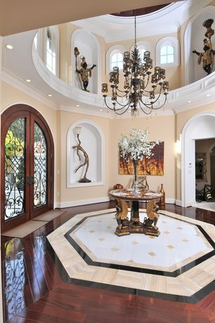 Traditional Entryway with Crown molding, Chandelier, Arched window, Hardwood floors, French doors, can lights
