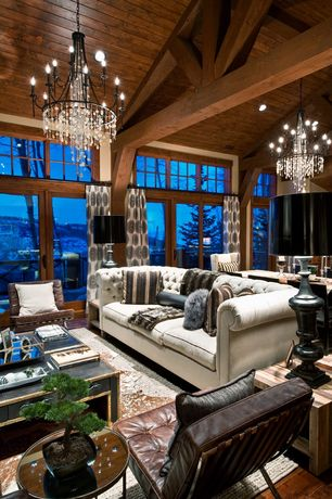 Contemporary Great Room with Chandelier, Exposed beam, Transom window, Hardwood floors, French doors, Cathedral ceiling