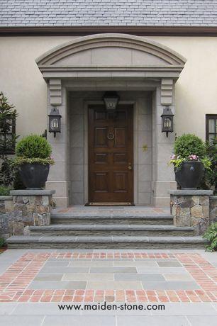 Traditional Front Door with exterior stone floors, six panel door, Raised beds