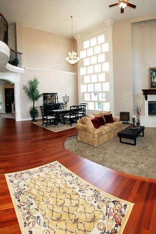 Traditional Living Room with flush light, Laminate floors, High ceiling, Loft, Ceiling fan, Chandelier, Chair rail