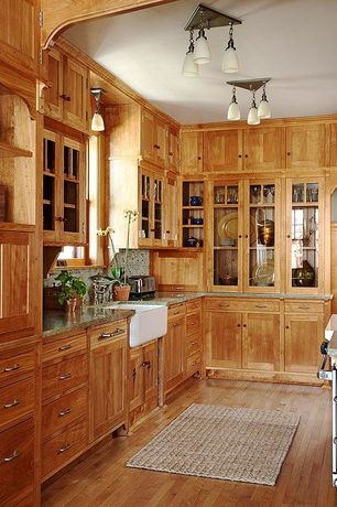 Craftsman Kitchen with Ceramic Tile, flush light, Inset cabinets, Glass panel, Simple granite counters, Flat panel cabinets