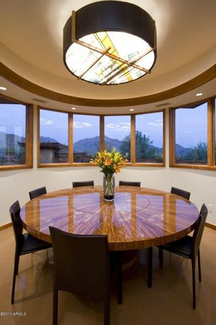 Modern Dining Room with flush light, picture window, can lights, Standard height, Concrete floors
