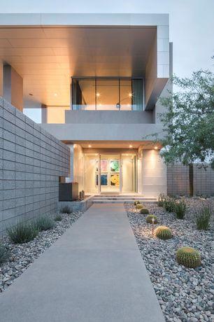 Modern Front Door with Drought tolerant plants, French doors, Fence, exterior tile floors, Deck Railing, Pathway