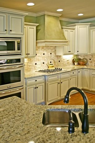 Traditional Kitchen with double wall oven, Subway Tile, full backsplash, Multiple Sinks, Custom hood, Simple granite counters