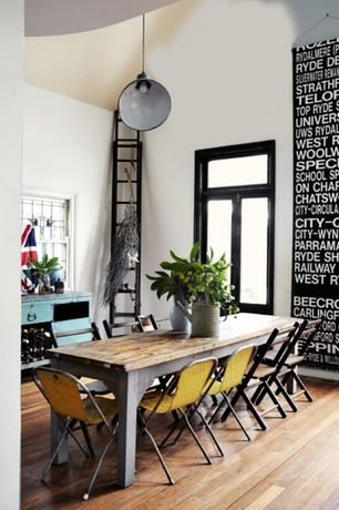 Eclectic Dining Room with double-hung window, Hardwood floors, High ceiling, Casement, Pendant light