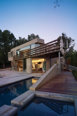 Contemporary Swimming Pool with Other Pool Type, Deck Railing, Transom window, sliding glass door, picture window