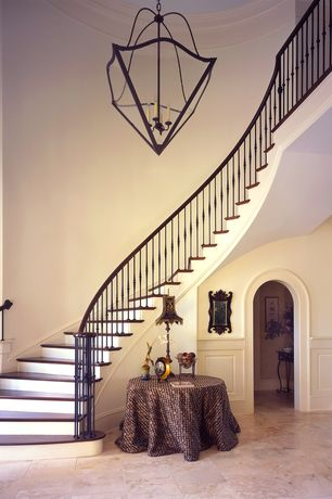 Traditional Staircase with sandstone tile floors, Loft, Crown molding, Cathedral ceiling, Chandelier