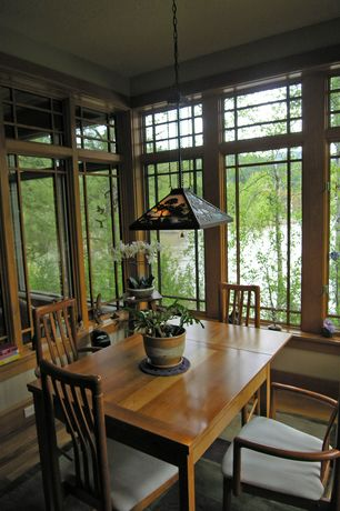 Traditional Dining Room with Wainscotting, Hardwood floors, flush light