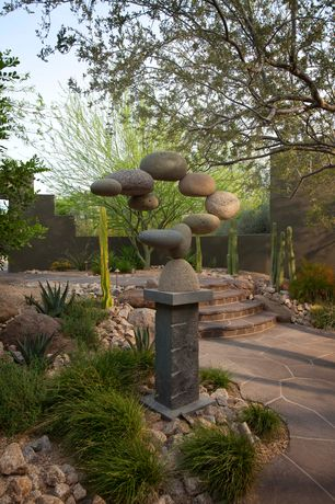 Modern Landscape/Yard with Concrete garden wall, Floating stone garden sculpture, Cactus