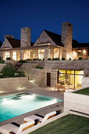 Traditional Swimming Pool with Raised beds, Pathway, Transom window, exterior stone floors, Pool with hot tub