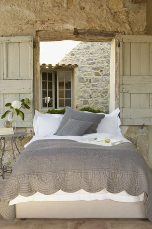 Rustic Guest Bedroom with limestone tile floors, Passport Perugia End Table, American Atelier Alligator Rectangle Tray