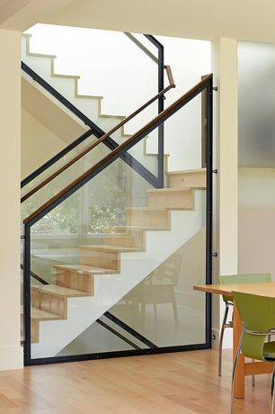 Contemporary Staircase with Hardwood floors, picture window, Columns, High ceiling, curved staircase
