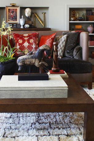 Eclectic Living Room with West elm kasbah wool rug, Hardwood floors, Built-in bookshelf