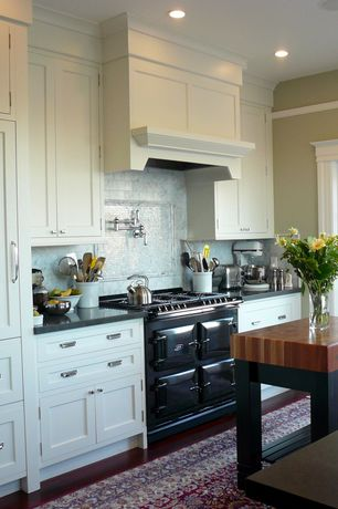 """Traditional Kitchen with Crown molding, Paint 1, Quartz counters, John boos butlers block - 5"""" thick maple butcher block top"""