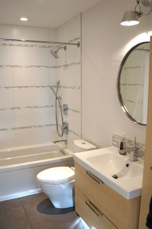 Contemporary Full Bathroom with European Cabinets, Handheld showerhead, tiled wall showerbath, Corian counters, Ceramic Tile