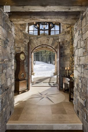 Country Entryway with Exposed beam, six panel door, Grandfather clock, simple granite floors, picture window, Chandelier