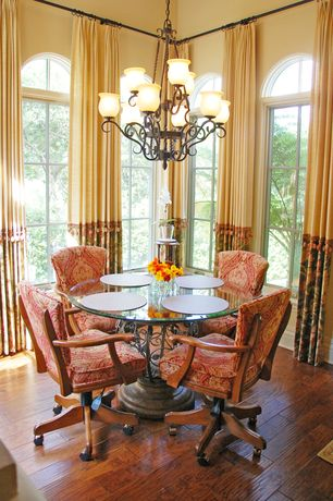 Eclectic Dining Room with Chandelier, Casement, Arched window, High ceiling, Hardwood floors