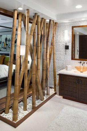 Asian Master Bathroom with Flat panel cabinets, Flush, Concrete floors, Limestone, Vessel sink, Limestone counters